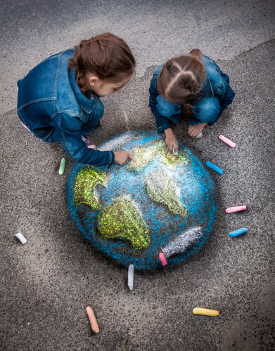 little girls chalk drawing earth planet