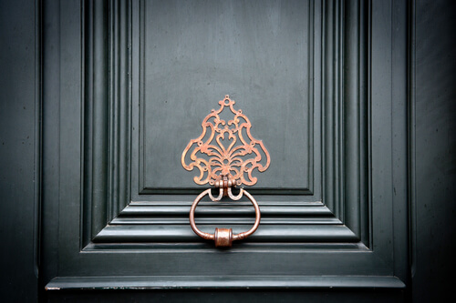 brass door knocker in Paris