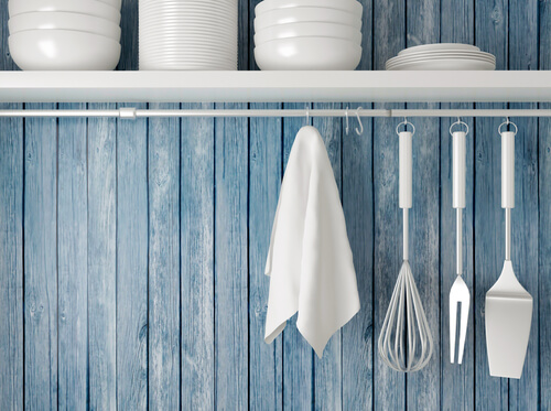 kitchen storage shelves plates hanging utensils