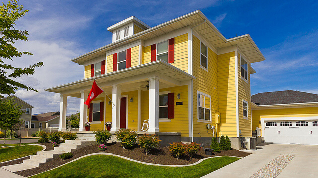 Best exterior paint colors for english colonial homes for Best yellow exterior paint color