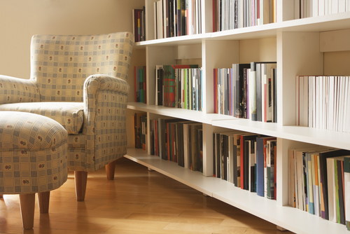 chair and bookshelves organized