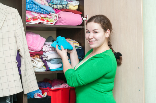 woman organizing her clothes storage space