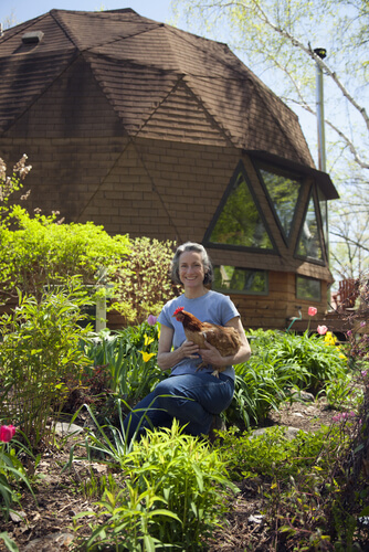geodesic dome home woman in garden