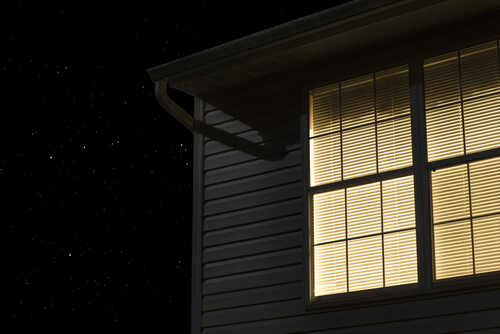 house exterior at night lit window stars