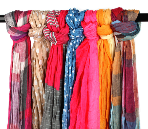 scarves hung on a closet beam