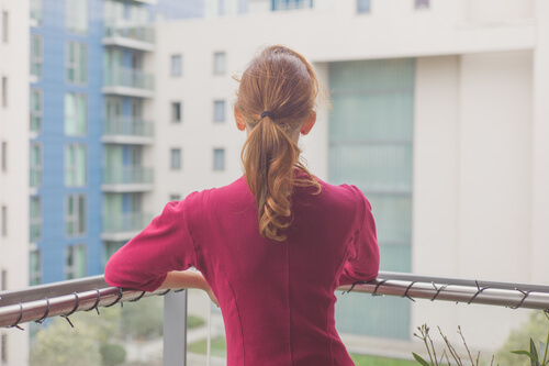 woman on apartment balcony
