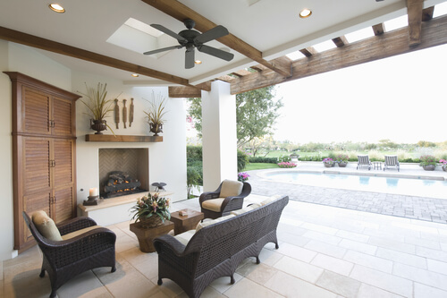 outdoor living room with overhead fan and swimming pool