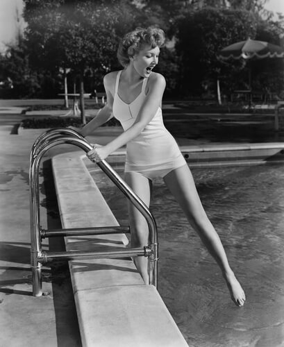 vintage woman swimming pool