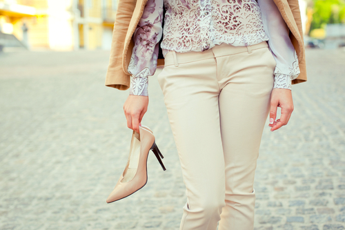 woman carrying high heels