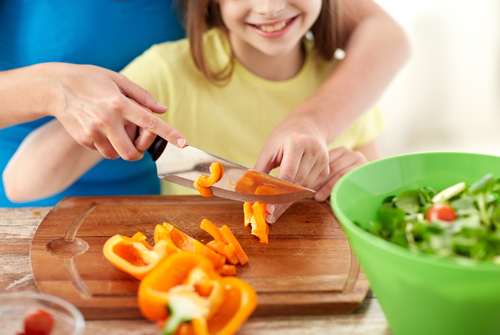 girl chopping vegetables